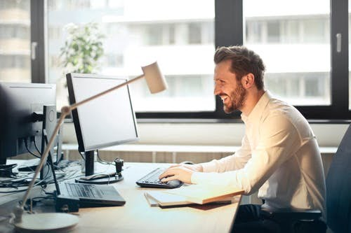 Man Setting Up Email Marketing Campaign